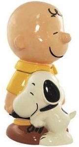 Charlies Brown and Snoopy hugging each other on this cookie jar